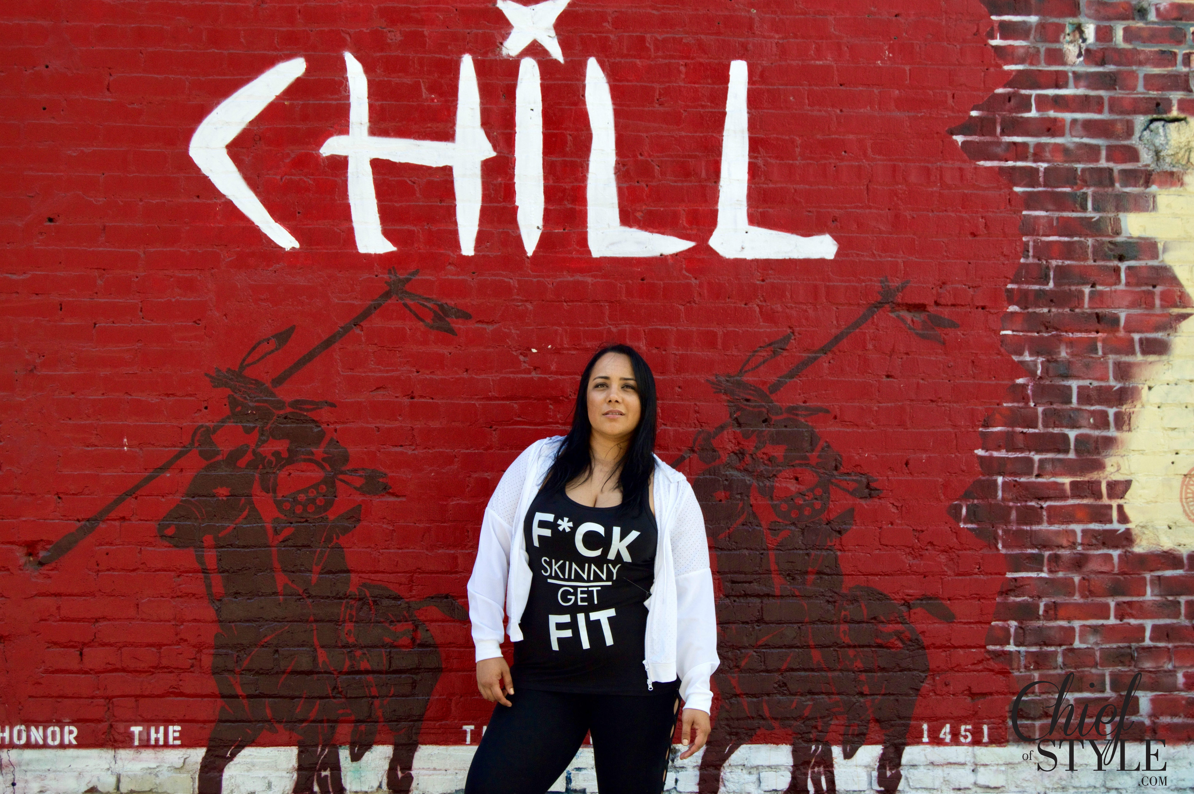 Amy Stretten, Chief of Style, plus style blogger modeling Forever 21 Plus and Nike in front of the murals on Indian Alley in Downtown Los Angeles.