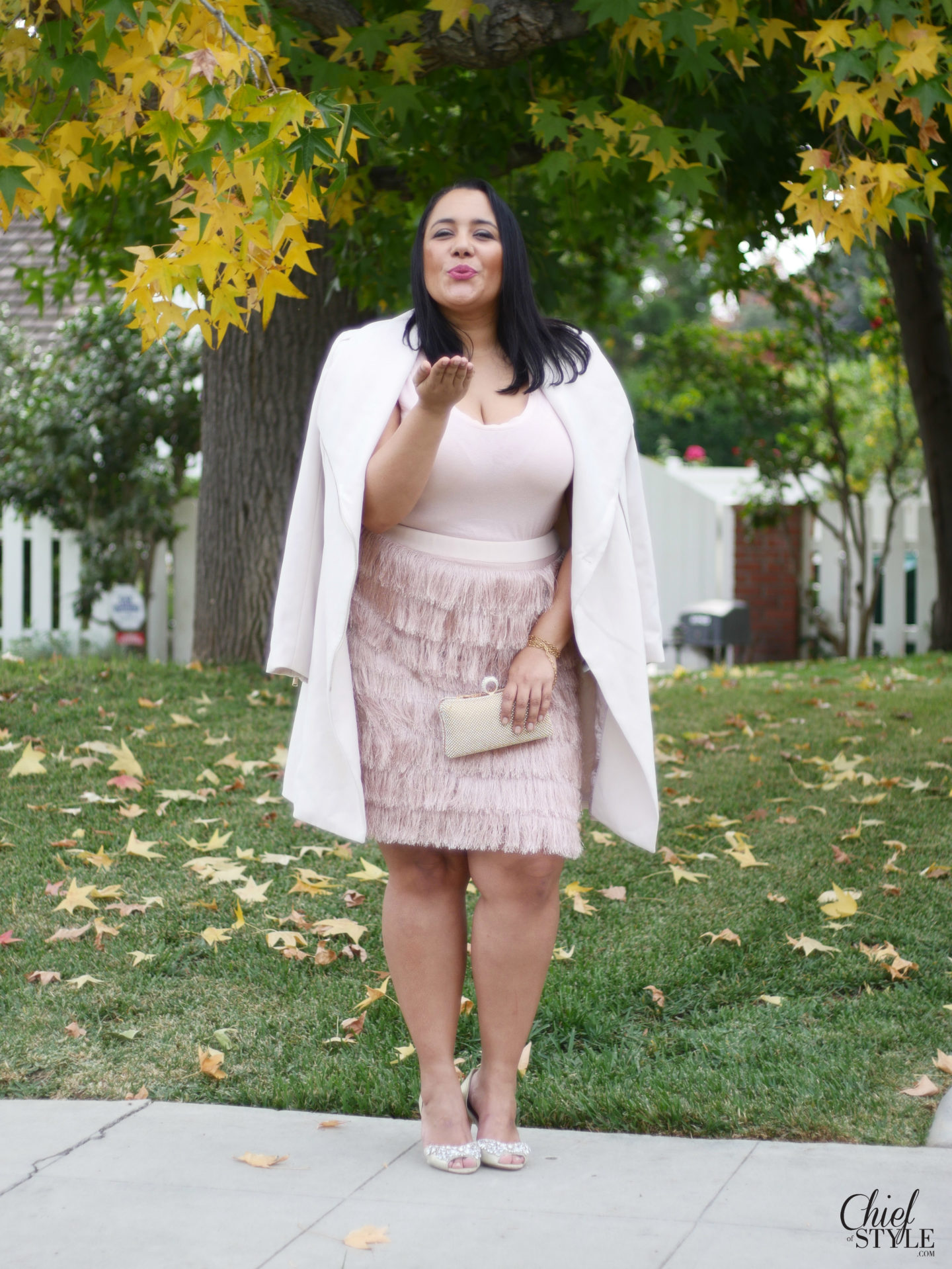 Amy Stretten Chief of Style wearing a soft pink plus size fringe pencil skirt by Eloquii