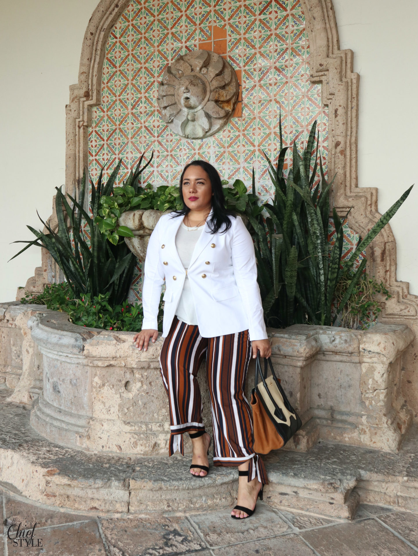 Amy Stretten Chief of Style in Palm Springs, California wearing plus size clothing by Lane Bryant blazer and Fashion Nova Pants with a Pour La Victoire tote bag