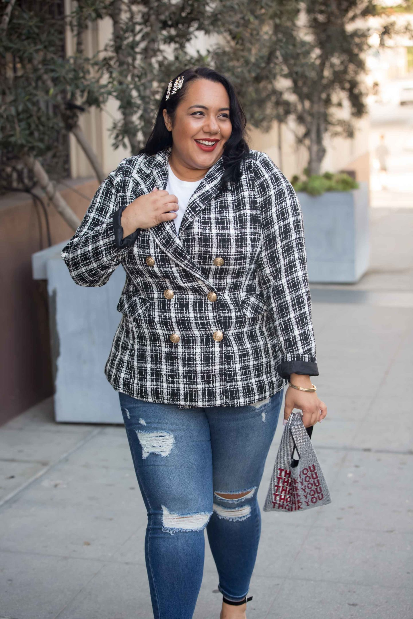 Amy Stretten, The Chief of Style, in a lane bryant blazer and plus size distressed jeans and a rhinestone thank you bag